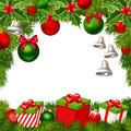 Christmas background with red and green balls, bells, gift boxes, fir-tree branches Royalty Free Stock Photo