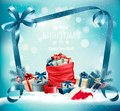 Christmas background with a red sack full presents and santa hat Royalty Free Stock Photo