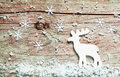 Christmas background with a reindeer in snow Royalty Free Stock Photo