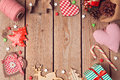 Christmas background with rustic Christmas decorations on wooden table. View from above Royalty Free Stock Photo