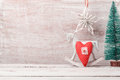 Christmas background with rustic decorations, rocking horse, pine tree and heart shape Royalty Free Stock Photo