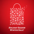 Christmas background with a shopping bag from snowflakes white on red striped Stock Photography