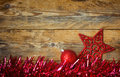 Christmas background with tinsel, red ball, star carved