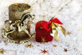 The christmas background with a toy horse and a gift Royalty Free Stock Photography