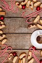 Christmas Background Vertical Wooden Background with Cup of Coffee Candy Cane and Cookies Top View Flat Lay