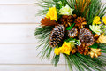 Christmas background with yellow silk roses and golden pine cone Royalty Free Stock Photo