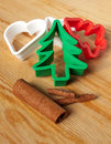 Christmas baking cookie cutters with cinnamon on the pastry board Stock Photos