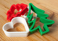 Christmas baking cookie cutters on the pastry board Royalty Free Stock Photography