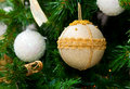 Christmas ball on christmas tree white and gold Royalty Free Stock Photos