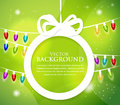 Christmas ball cut from paper on green background with multicolor lights Royalty Free Stock Photo