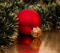 Christmas ball on the golden background Stock Photos