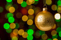 Christmas ball hanging defocused sparkling lights on the background Stock Images