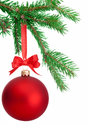 Christmas ball hanging on a fir tree branch isolated on white background Royalty Free Stock Photos