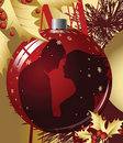 Christmas ball with kissing couple. Stock Image