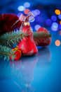 Christmas ball red on a blue background Royalty Free Stock Image
