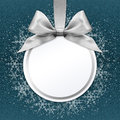 Christmas ball with silver satin ribbon bow on blue Royalty Free Stock Photo