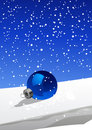Christmas ball on the snow Stock Image
