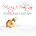 Christmas ball in the snow with merry christmas greeting and sample text