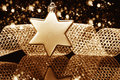 Christmas ball in star shape in front of a metal r Royalty Free Stock Image