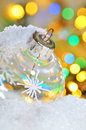 Christmas ball transparent on snowy winter and yellow lights Stock Photo