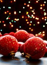 Christmas balls on the background lights. Royalty Free Stock Photo
