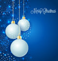 Christmas balls background with stars and Royalty Free Stock Images