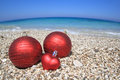Christmas balls on the beach Stock Photo