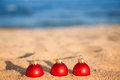 Christmas balls on beach Stock Image