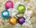 Christmas balls on bed of tinsel Royalty Free Stock Image
