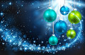 Christmas balls on a blue background color with snowflakes and bright rays of light Royalty Free Stock Images