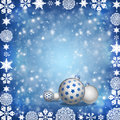 Christmas balls on blue background new year s and snowflakes a Royalty Free Stock Image