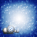 Christmas balls on blue background new year s and snowflakes a Stock Photo