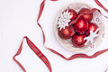 Christmas balls in a bowl on white background Royalty Free Stock Photo