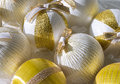 Christmas balls in a box white and gold lit by the sun Stock Photos