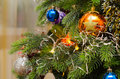 Christmas balls on branches of artificial holiday Christmas tree Royalty Free Stock Photo
