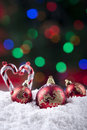 Christmas balls with candy cane ornament on snow Stock Photography