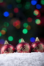 Christmas balls with defocused christmas lights Royalty Free Stock Image
