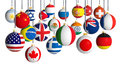 Christmas balls with different flags hanging on white background Royalty Free Stock Photography