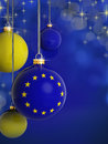 Christmas balls with european union flag in front of lights background Royalty Free Stock Photos