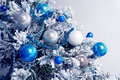 Christmas balls on fir tree. Blue and white. New Year holidays and Christmastime celebration Royalty Free Stock Photo