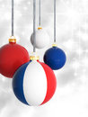 Christmas balls with french flag in front of lights background Stock Photography