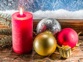 Christmas balls and frozen window on backgroun Royalty Free Stock Photo