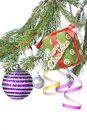 Christmas balls, gift and decoration on fir tree Stock Photography