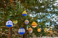 Christmas balls hanging on pine branches covered with snow Royalty Free Stock Photo