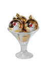 Christmas balls in the ice cream glass bowl isolated on white Royalty Free Stock Photo