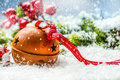 Christmas balls jingle bells. Red  ribbon with text Happy Christmas. Snowy abstract background and decoration Royalty Free Stock Photo
