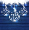 Christmas balls made in snowflakes on blue wooden background Royalty Free Stock Photo