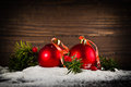 Christmas balls on new year s eve in snow Stock Photography