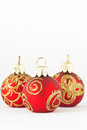 Christmas balls in red and gold three Stock Images