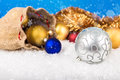 Christmas balls and santa s pack on the snow Royalty Free Stock Photos
